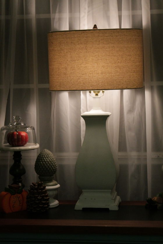 The lamp was purchased for $6.00 and the shade was bought at a different time for $2.00.  The lamp was gold... I painted it.
